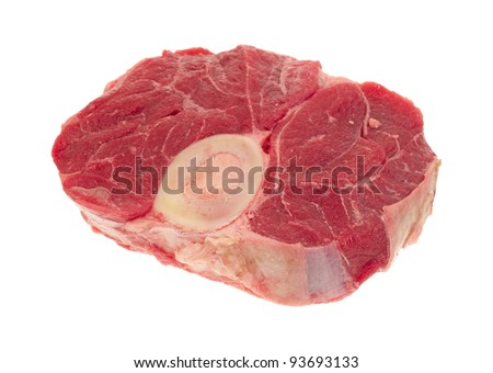 Fresh beef hind shank steak with bone on a white background. - stock photo