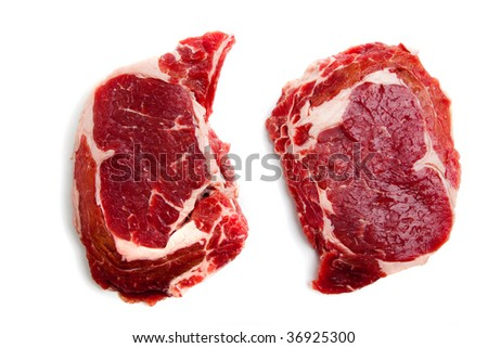 Fresh Beef rib-eye steak on white background - stock photo