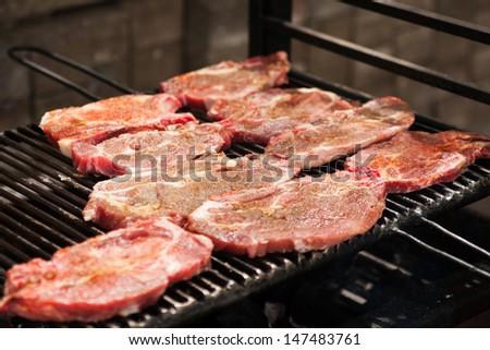 Fresh beef steak on grill - stock photo