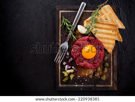 fresh beef tartar with egg, close-up. - stock photo