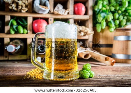 Fresh beer and ingredients in wooden box - stock photo