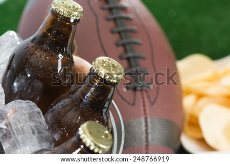 Fresh beer in a cooler with ice - stock photo
