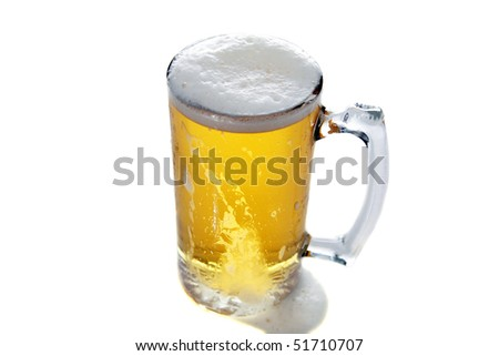 fresh beer in a large frosted glass mug isolated on white - stock photo