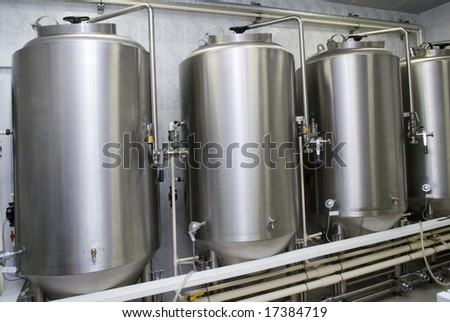 fresh beer on a small brewery - stock photo