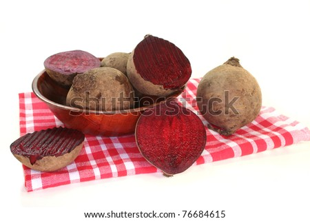 fresh beet root in a wooden bowl on a white background - stock photo