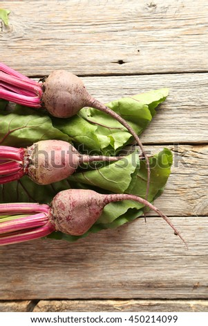Fresh beets on a grey wooden table