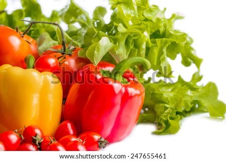 fresh bell pepper, tomato and lettuce on white background - stock photo