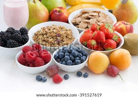 fresh berries, fruit and muesli, close-up - stock photo