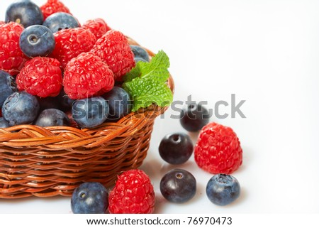 fresh berries fruits in a wooden basket - stock photo