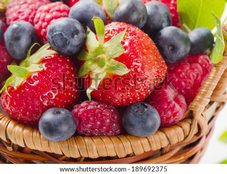 Fresh berries in a basket. Selective focus - stock photo