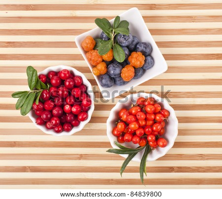 Fresh berries in a  wooden  surface - stock photo