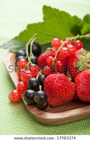 fresh berries in wooden bowl - stock photo