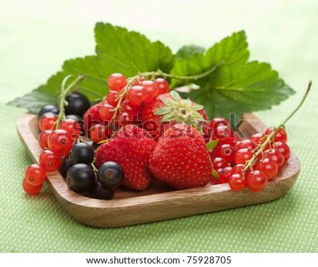 fresh berries in wooden bowl - stock photo