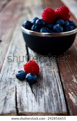 Fresh Berries on Rustic Wooden Background. Summer or Spring Organic Berry over Wood. Agriculture, Gardening, Harvest Concept. Selective focus. - stock photo