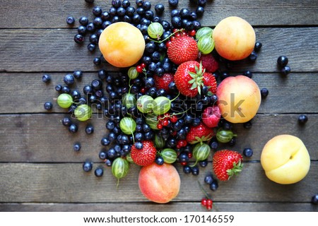 fresh berries on the table, top view, food closeup - stock photo