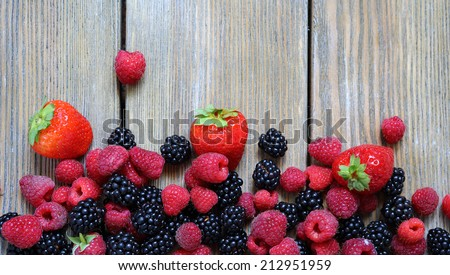 fresh berries on wooden background food closeup - stock photo
