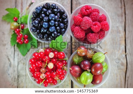 Fresh berries - red and white currant, gooseberry, blueberry and raspberry - stock photo