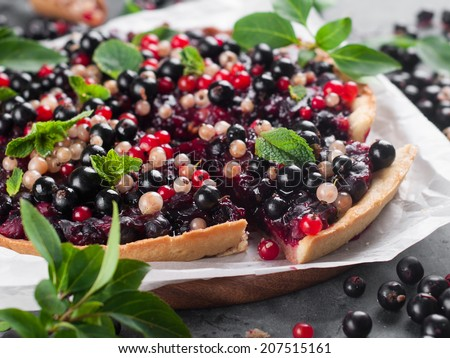 Fresh berries tart with mint, selective focus - stock photo