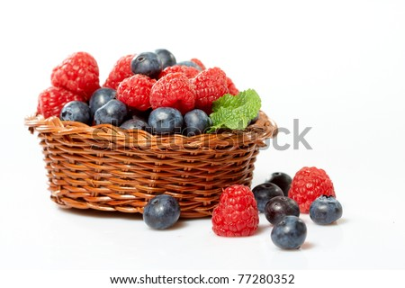 fresh berry fruits in a wooden basket - stock photo