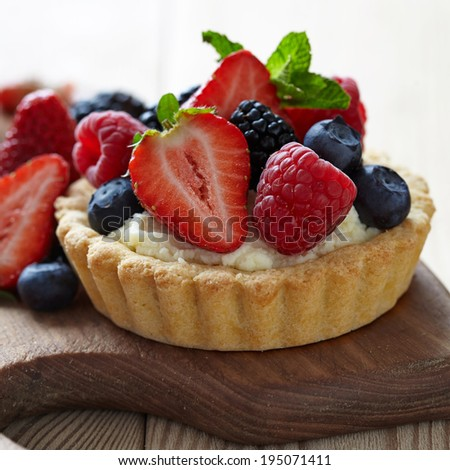 Fresh Berry Tartlets with strawberry, raspberry, blueberry and blackberry - stock photo