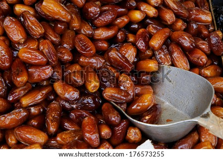Fresh big dates in copper bowl - stock photo