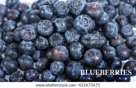 Fresh Bilberries or blueberry. Close-up background. Shallow DOF - stock photo
