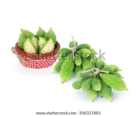 Fresh bitter gourd in basket isolated on white background with clipping path.  - stock photo