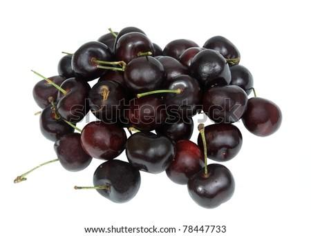 fresh black cherries on a white background - stock photo