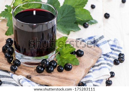 Fresh Black Currant juice with some fruits - stock photo