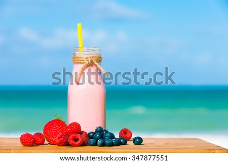 Fresh blended berries in a shake.    - stock photo