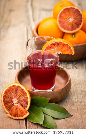 Fresh blood orange juice in a glass - stock photo