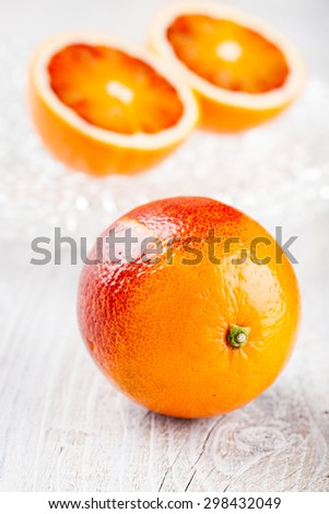 Fresh blood oranges on glass plates
