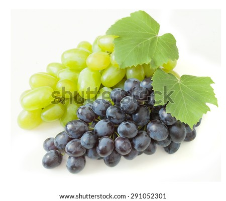 Fresh blue and green grapes with leaves. Isolated on white - stock photo