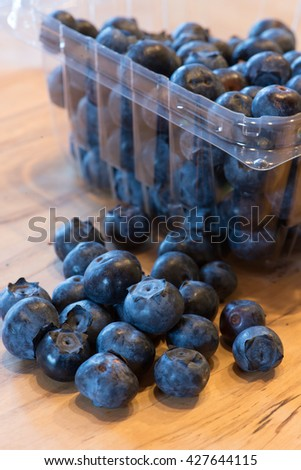 Fresh blueberries from a farmer's market are on the counter ready for consumption. - stock photo