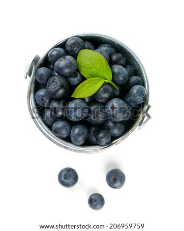 fresh blueberries in a bucket over white - stock photo