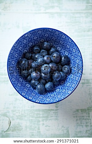 Fresh blueberries in a ceramic bowl - stock photo