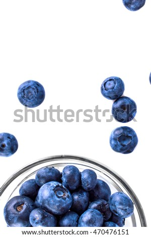 Fresh blueberries in a jar on a white background