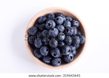 fresh blueberries in a wooden bowl