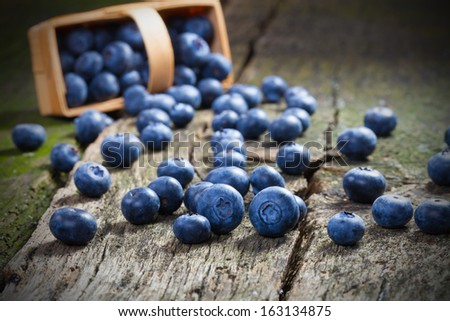 Fresh blueberries on old wood