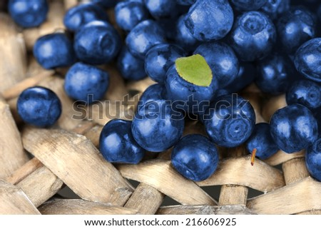 Fresh blueberries on wicker mat close-up - stock photo
