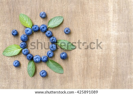 Fresh blueberries with mint leaves. Top view - stock photo