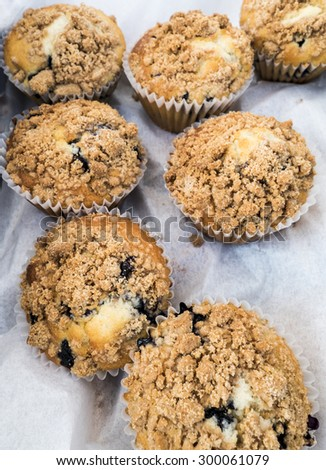 Fresh blueberry muffins just out of oven. - stock photo
