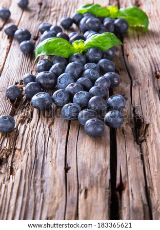 Fresh blueberry on wooden table. Berry - wood. Garden fruits. Organic