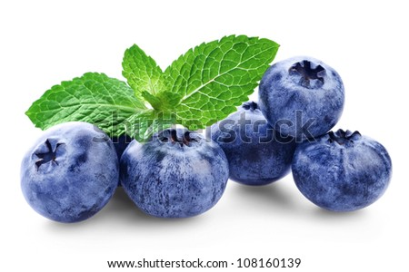 Fresh blueberry with green leafs of mint on white background - stock photo