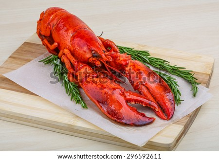 Fresh boiled lobster with rosemary on the wood background - stock photo