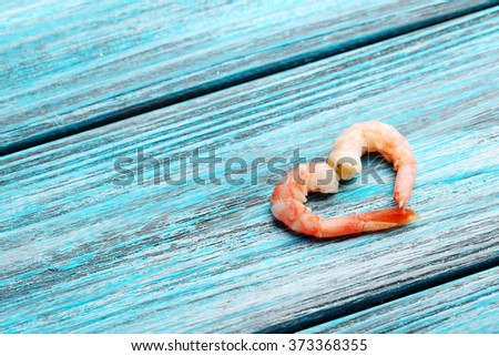Fresh boiled shrimps on a blue wooden table - stock photo