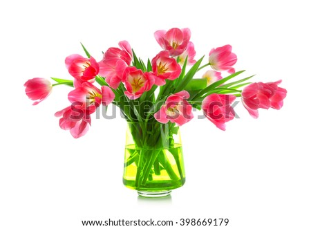 Fresh bouquet of tulips in a vase isolated on white - stock photo