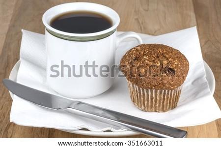 Fresh bran muffin and coffee - stock photo
