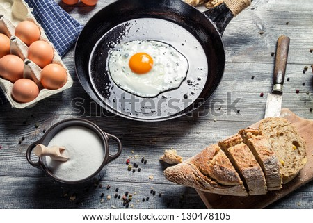 Fresh bread and fried egg for breakfast - stock photo