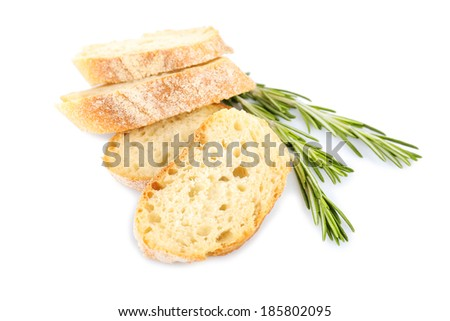 Fresh bread and rosemary isolated on white - stock photo